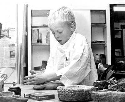 Youth participating in OAS pottery class.
