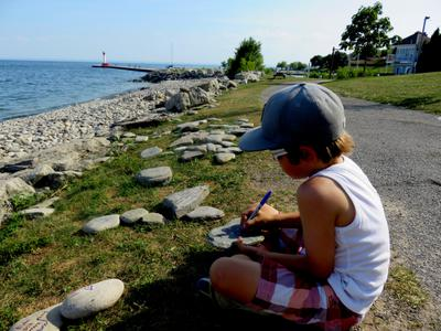 Oakville Boy writes message on Oakville Rockpile