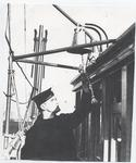 Sailor ringing ships bell