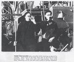 Two sailors drinking Coca Cola on HMCS OAKVILLE