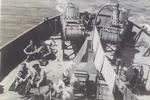 Crew members on HMCS Oakville laundry day