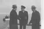 Lt. A.C. Jones R.C.N.R., Commanding Officer of HMCS Oakville Meets Oakville Officials