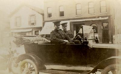 James Byron Kelley at wheel of car on Colborne Street (now Lakeshore Road), Oakville